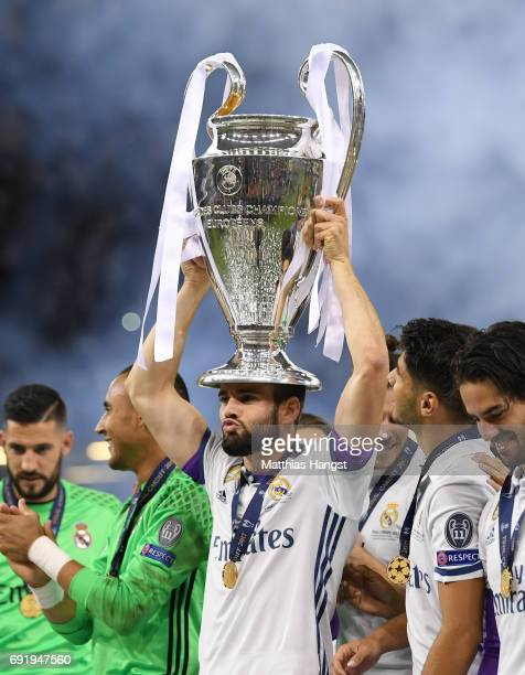 Daniel Carvajal of Real Madrid celebrates with The Champions League trophy after the UEFA Champions League Final between Juventus and Real Madrid at...