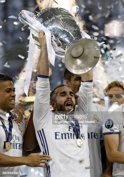 Daniel Carvajal of Real Madrid celebrates with the trophy after the UEFA Champions League Final match between Juventus and Real Madrid at National...