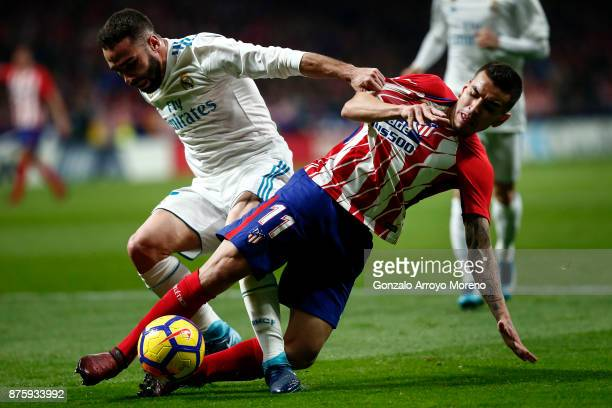 Daniel Carvajal of Real Madrid CF acfb Angel Martin Correa of Atletico de Madrid during the La Liga match between Club Atletico Madrid and Real...