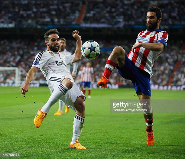 Daniel Carvajal of Real Madrid CF and Arda Turan of Atletico Madrid challenge for the ball during the UEFA Champions League quarterfinal second leg...