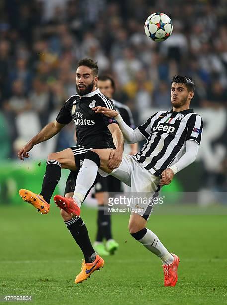 Daniel Carvajal of Real Madrid CF battles with Alvaro Morata of Juventus during the UEFA Champions League semi final first leg match between Juventus...