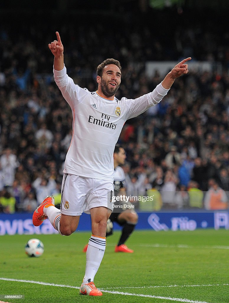 Daniel Carvajal of Real Madrid CF celebrates after scoring Real's 4th goal from a free kick during the La Liga match between Real Madrid CF and CA Osasuna at the Santiago Bernabeu stadium on April 26, 2014 in Madrid, Spain.