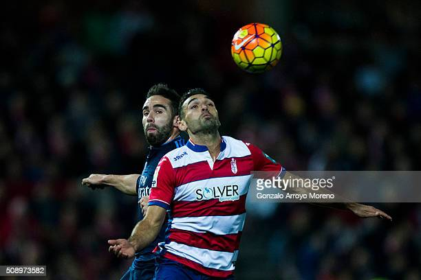 Daniel Carvajal of Real Madrid CF competes for the ball with David Barral of Granada CFa during the La Liga match between Granada CF and Real Madrid...