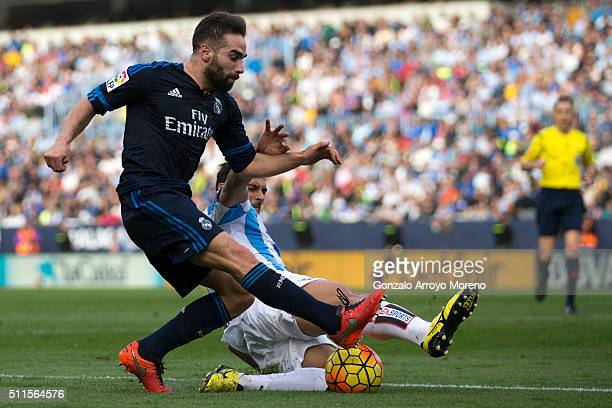 Daniel Carvajal of Real Madrid CF competes for the ball with Roque Santa Cruz of Malaga CF during the La Liga match between Malaga CF and Real Madrid...