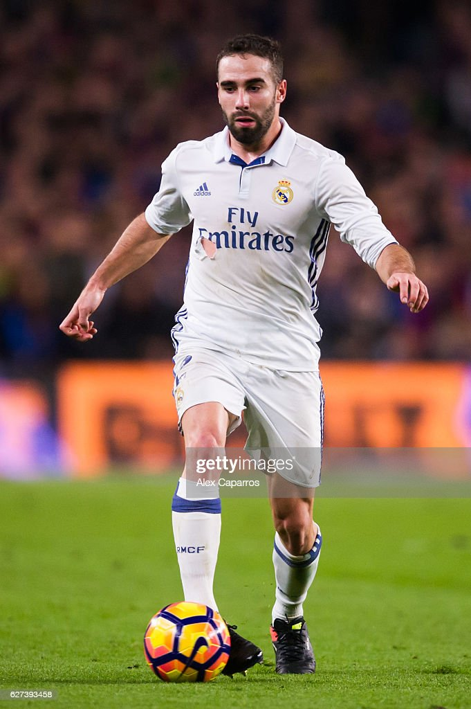 Daniel Carvajal of Real Madrid CF conducts the ball during the La Liga match between FC Barcelona and Real Madrid CF at Camp Nou stadium on December...
