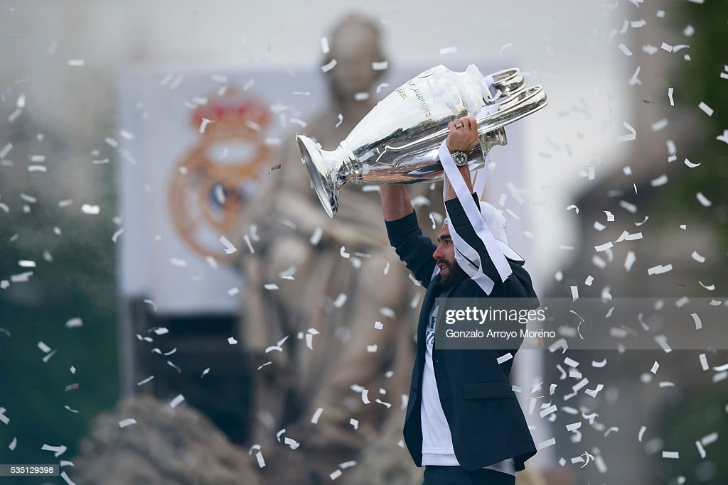 Daniel Carvajal of Real Madrid CF holds the trophy in celebration during their team celebration at Cibeles square after winning the Uefa Champions League Final match agains Club Atletico de Madrid on May 29, 2016 in Madrid, Spain.