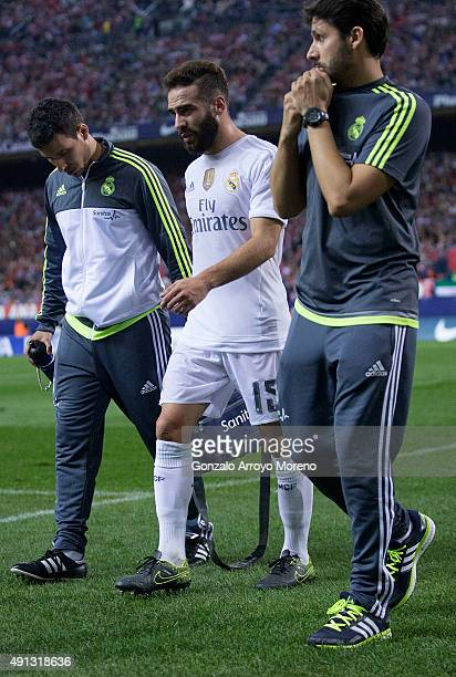 Daniel Carvajal of Real Madrid CF leaves the pitch assited by medical staff during the La Liga match between Club Atletico de Madrid and Real Madrid...