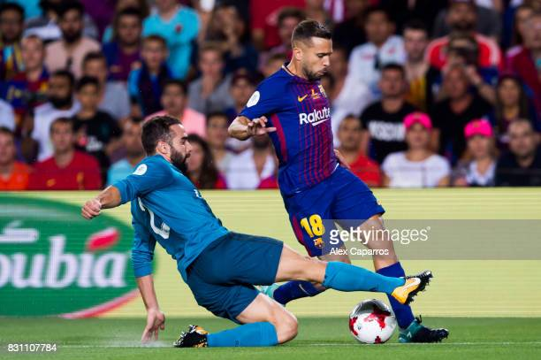 Daniel Carvajal of Real Madrid CF tackles Jordi Alba of FC Barcelona during the Supercopa de Espana Supercopa Final 1st Leg match between FC...
