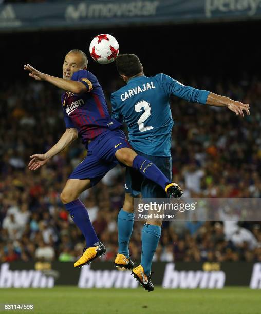 Daniel Carvajal of Real Madrid competes for the ball with Andres Iniesta of FC Barcelona during the Supercopa de Espana Final first leg match between...