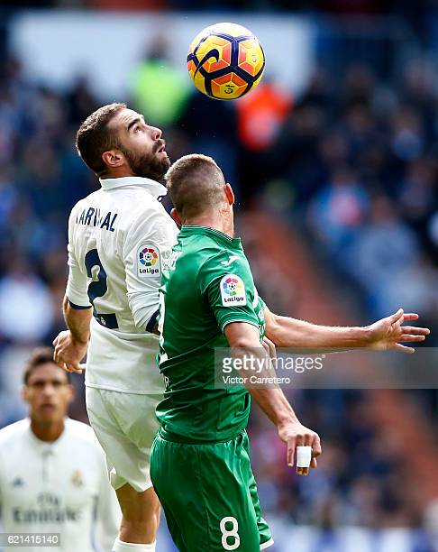 Daniel Carvajal of Real Madrid competes for the ball with Gabriel Pires of Leganes during the La Liga match between Real Madrid CF and Leganes at...
