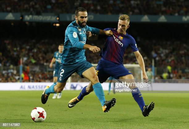 Daniel Carvajal of Real Madrid competes for the ball with Gerard Deulofeu of FC Barcelona during the Supercopa de Espana Final first leg match...