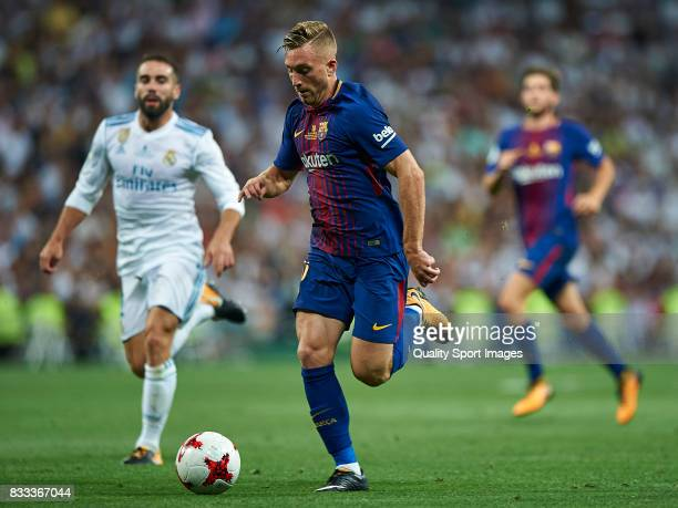 Daniel Carvajal of Real Madrid competes for the ball with Gerard Deulofeu of Barcelona during the Supercopa de Espana Supercopa Final 2nd Leg match...