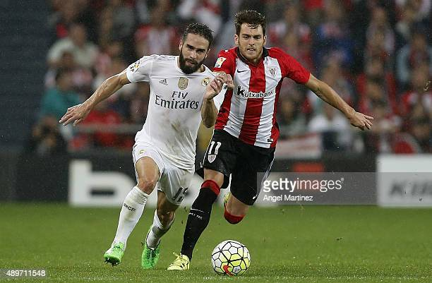 Daniel Carvajal of Real Madrid competes for the ball with Ibai Gomez of Athletic Club during the La Liga match between Athletic Club and Real Madrid...