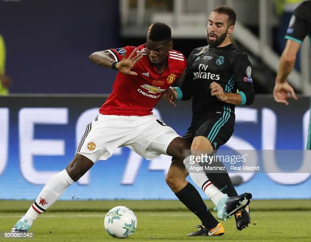 Daniel Carvajal of Real Madrid competes for the ball with Paul Pogba of Manchester United during the UEFA Super Cup match between Real Madrid and...