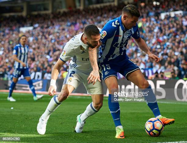 Daniel Carvajal of Real Madrid competes for the ball with Theo Hernandez of Deportivo Alaves during the La Liga match between Real Madrid and...