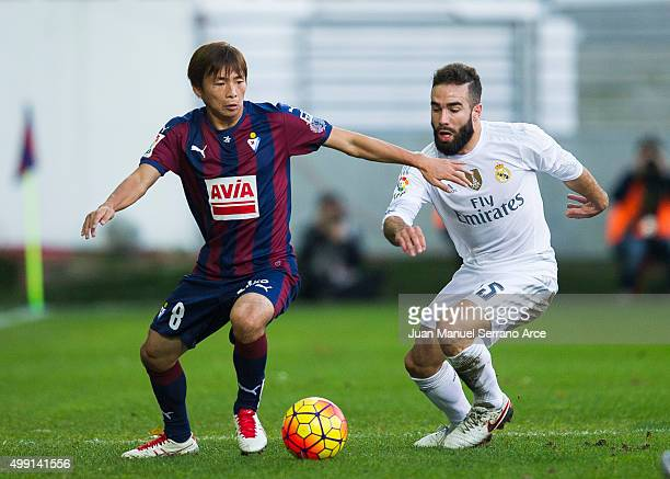 Daniel Carvajal of Real Madrid duels for the ball with Takashi Inui of SD Eibar during the La Liga match between SD Eibar and Real Madrid at Ipurua...