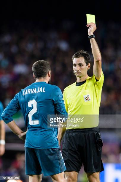 Daniel Carvajal of Real Madrid gets a yellow card from Fifa Referee Ricardo de Burgos Bergoetxea during the Supercopa de Espana Final 1st Leg match...