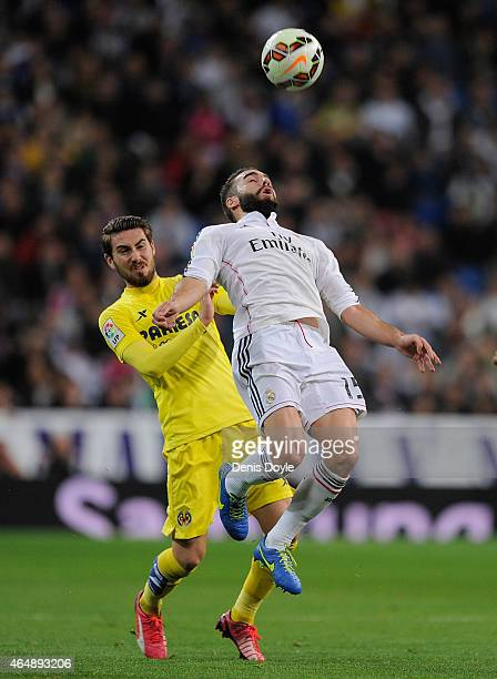 Daniel Carvajal of Real Madrid goes for a high ball ahainst Moi Gomez of Villarreal during the La Liga match between Real Madrid and Villarreal at...