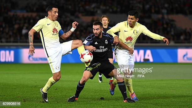 Daniel Carvajal of Real Madrid holds off Silvio Romero of Club America and Rubens Sambueza of Club America during the FIFA Club World Cup Semi Final...