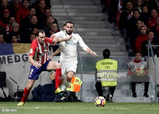Daniel Carvajal of Real Madrid in action against Diego Godin of Atletico Madrid during the Spanish La Liga match between Atletico Madrid and Real...