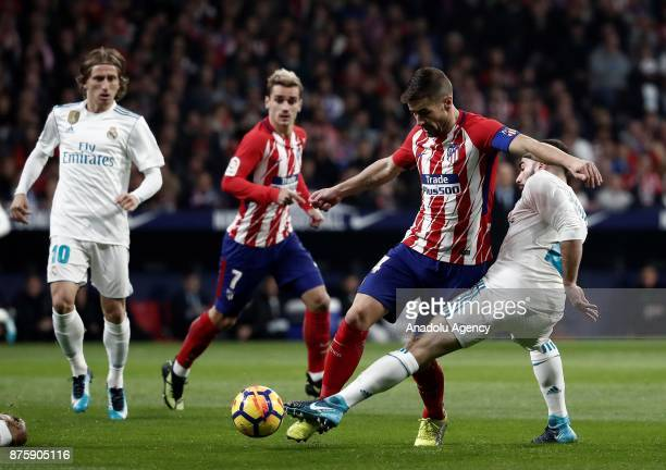 Daniel Carvajal of Real Madrid in action against Gabi of Atletico Madrid during the Spanish La Liga match between Atletico Madrid and Real Madrid at...