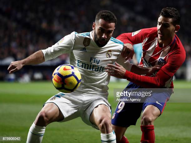 Daniel Carvajal of Real Madrid in action against Lucas Hernandez of Atletico Madrid during the Spanish La Liga match between Atletico Madrid and Real...
