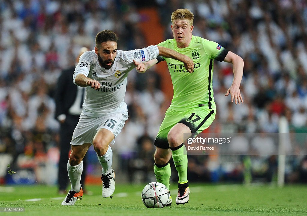 Daniel Carvajal of Real Madrid is chased by Kevin de Bruyne of Manchester City during the UEFA Champions League semi final, second leg match between Real Madrid and Manchester City FC at Estadio Santiago Bernabeu on May 4, 2016 in Madrid, Spain.