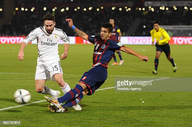 Daniel Carvajal of Real Madrid is in action against Pablo Barrientos of San Lorenzo during the FIFA Club World Cup Final between Real Madrid and San...