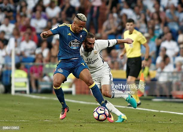 Daniel Carvajal of Real Madrid is in action against Theo Bongonda of Celta Vigo during the Spanish first league La Liga soccer match between Real...