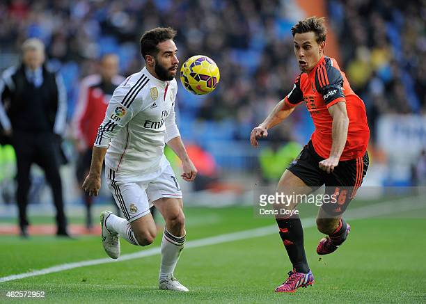 Daniel Carvajal of Real Madrid is tackled by Sergio Canales of Real Sociedad Club De Futbol during the La Liga match between Real Madrid CF and Real...