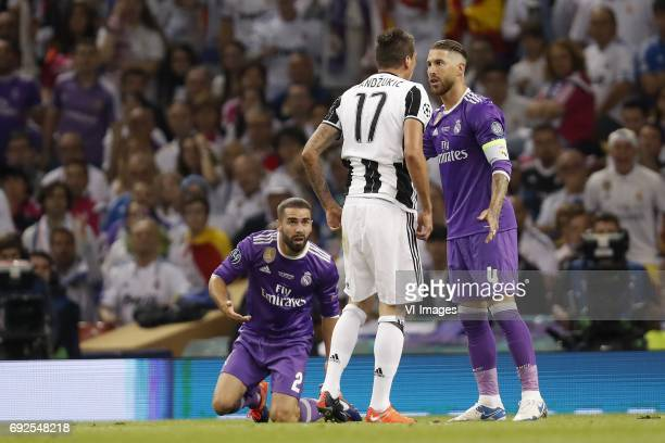 Daniel Carvajal of Real Madrid Lucas Vazquez of Real Madrid Sergio Ramos of Real Madridduring the UEFA Champions League final match between Juventus...