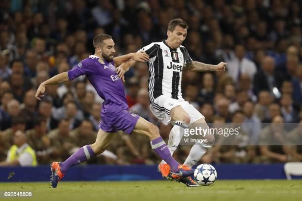 Daniel Carvajal of Real Madrid Mario Mandzukic of Juventus FCduring the UEFA Champions League final match between Juventus FC and Real Madrid on June...