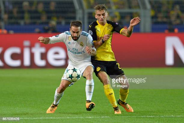 Daniel Carvajal of Real Madrid Maximilian Philipp of Dortmund battle for the ball during the UEFA Champions League group H match between Borussia...