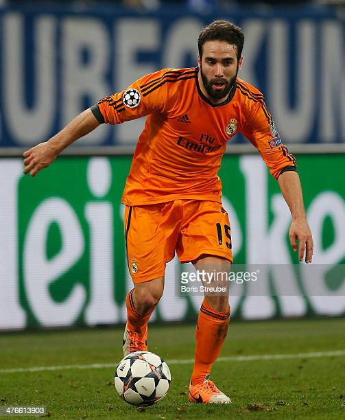 Daniel Carvajal of Real Madrid runs with the ball during the UEFA Champions League Round of 16 first leg match between Schalke 04 and Real Madrid CF...