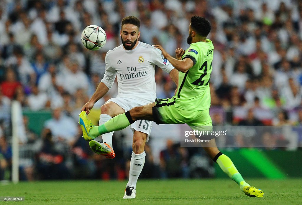Daniel Carvajal of Real Madrid takes the ball past <a gi-track='captionPersonalityLinkClicked' href=/galleries/search?phrase=Gael+Clichy&family=editorial&specificpeople=214646 ng-click='$event.stopPropagation()'>Gael Clichy</a> of Manchester City during the UEFA Champions League semi final, second leg match between Real Madrid and Manchester City FC at Estadio Santiago Bernabeu on May 4, 2016 in Madrid, Spain.