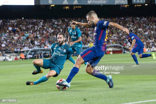 Daniel Carvajal of Real Madrid trips up with Jordi Alba of FC Barcelona during the Supercopa de Espana Final 1st Leg match between FC Barcelona and...