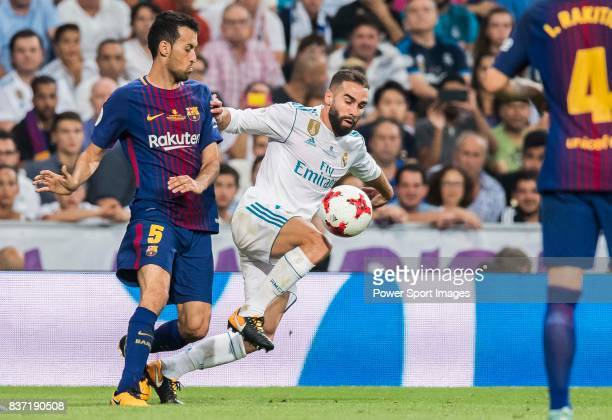 MADRID SPAIN AUGUST 16 Daniel Carvajal Ramos of Real Madrid competes for the ball with Sergio Busquets Burgos of FC Barcelona during their Supercopa...