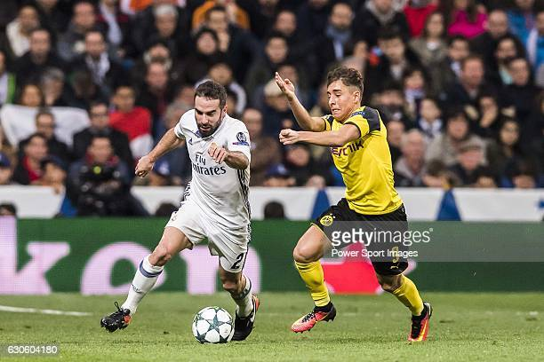 Daniel Carvajal Ramos of Real Madrid fights for the ball with Emre Mor of Borussia Dortmund during the 201617 UEFA Champions League match between...
