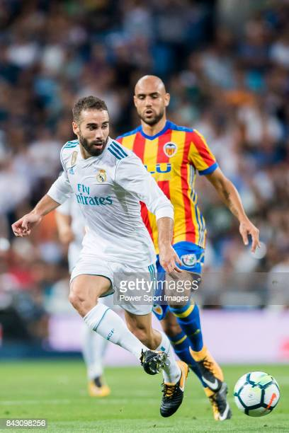 Daniel Carvajal Ramos of Real Madrid is followed by Simone Zaza of Valencia CF during their La Liga 201718 match between Real Madrid and Valencia CF...