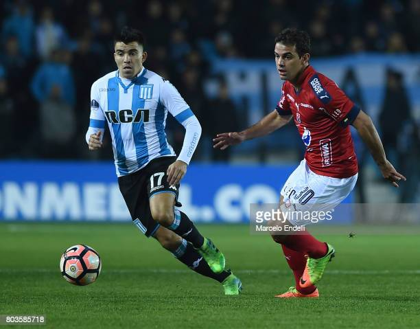 Daniel Castano of Independiente Medellin and Marcos Acuña of Racing Club fight for the ball during the first leg match between Racing Club and...