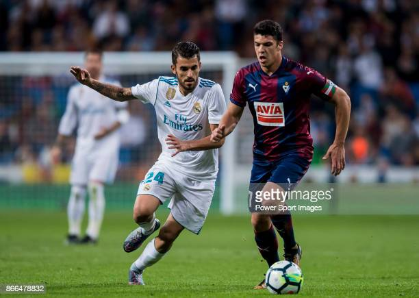 Daniel Ceballos Fernandez D Ceballos of Real Madrid fights for the ball with Ander Capa Rodriguez of SD Eibar during the La Liga 201718 match between...