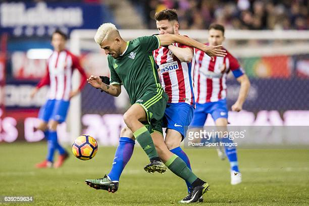 Daniel Ceballos Fernandez 'Dani Ceballos' of Real Betis Balompie fights for the ball with Saul Niguez Esclapez of Atletico de Madrid during their La...