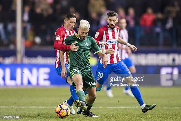 Daniel Ceballos Fernandez 'Dani Ceballos' of Real Betis Balompie competes for the ball with Fernando Torres and Yannick Ferreira Carrasco of Atletico...