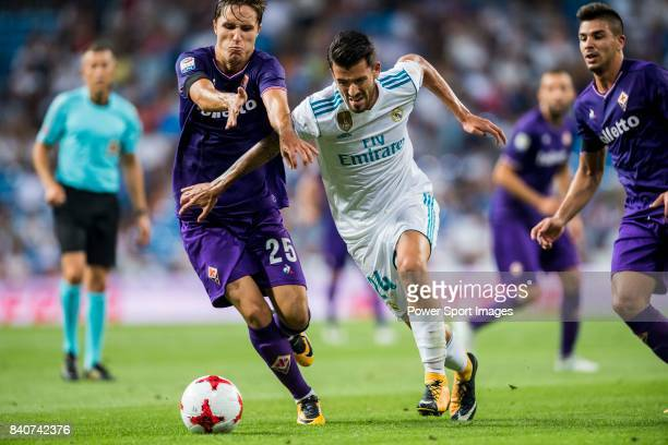 Daniel Ceballos Fernandez Dani Ceballos of Real Madrid competes for the ball with Federico Chiesa of ACF Fiorentina during the Santiago Bernabeu...