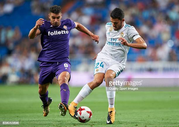 Daniel Ceballos of Real Madrid competes for the ball with Giovanni Simeone of Fiorentina during the Trofeo Santiago Bernabeu match between Real...