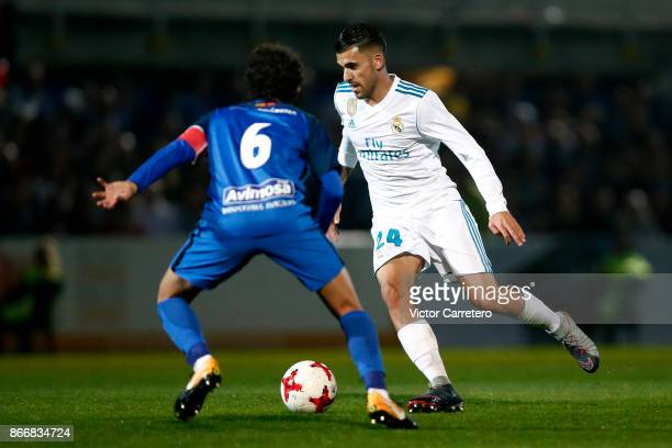 Daniel Ceballos of Real Madrid competes for the ball with Luis Milla of Fuenlabrada during the Copa del Rey round of 32 first leg match between...