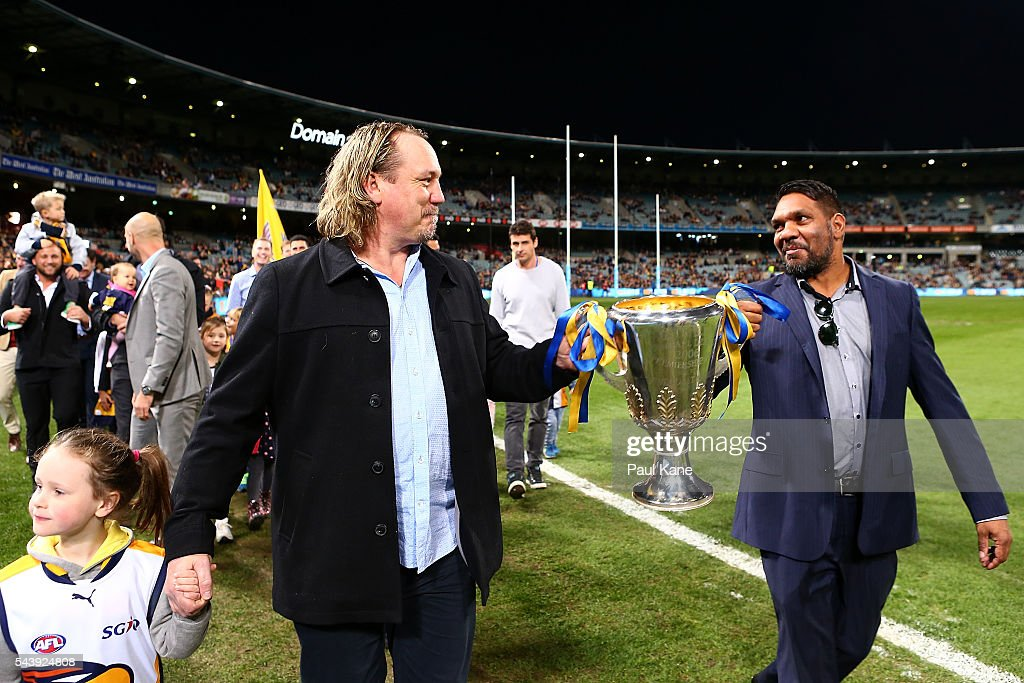 <a gi-track='captionPersonalityLinkClicked' href=/galleries/search?phrase=Daniel+Chick&family=editorial&specificpeople=215026 ng-click='$event.stopPropagation()'>Daniel Chick</a> and David Wirrpanda walk a lap of honour with team mates celebrating the West Coast Eagles 2006 Premiership anniversary during the round 15 AFL match between the West Coast Eagles and the Essendon Bombers at Domain Stadium on June 30, 2016 in Perth, Australia.