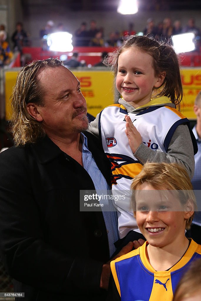 <a gi-track='captionPersonalityLinkClicked' href=/galleries/search?phrase=Daniel+Chick&family=editorial&specificpeople=215026 ng-click='$event.stopPropagation()'>Daniel Chick</a> looks on with his children before walking a lap of honour with team mates celebrating the West Coast Eagles 2006 Premiership anniversary during the round 15 AFL match between the West Coast Eagles and the Essendon Bombers at Domain Stadium on June 30, 2016 in Perth, Australia.