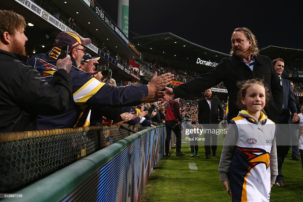 <a gi-track='captionPersonalityLinkClicked' href=/galleries/search?phrase=Daniel+Chick&family=editorial&specificpeople=215026 ng-click='$event.stopPropagation()'>Daniel Chick</a> walks a lap of honour with team mates celebrating the West Coast Eagles 2006 Premiership anniversary during the round 15 AFL match between the West Coast Eagles and the Essendon Bombers at Domain Stadium on June 30, 2016 in Perth, Australia.