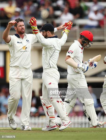 Daniel Christian of the Bushrangers celebrates with teammate Matthew Wade after Christian got the wicket of Travis Head of the Redbacks during day 1...